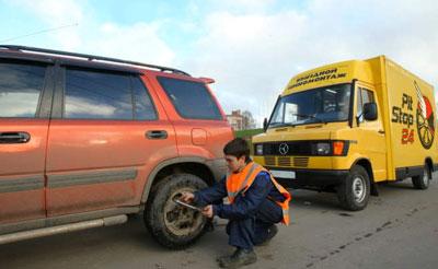 снятие грузового колеса